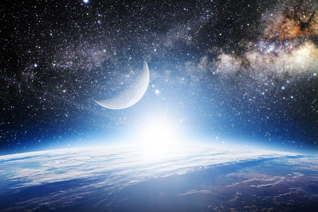 Moon and stars in space above planet