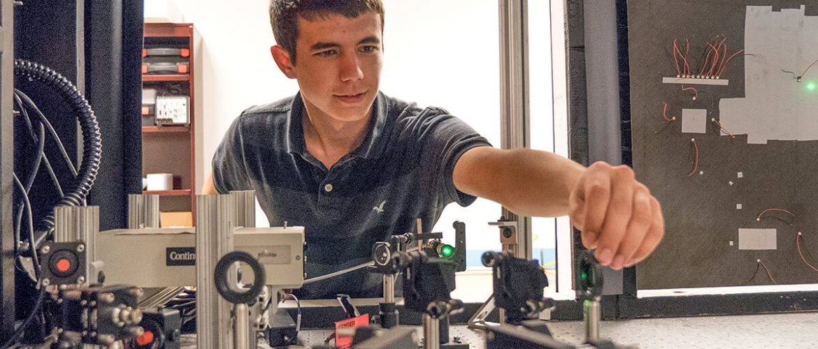Student aligns piece of equipment before test