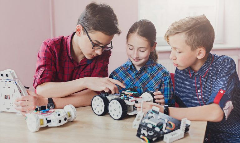 Children creating robots at school stem education
