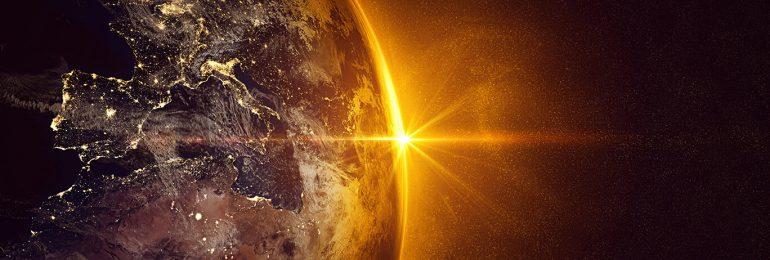 Sunrise over Earth in space with orange illumination